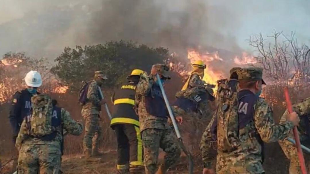 Foto: La Coordinación Nacional de Protección Civil informó que continúa el combate a los siniestros forestales en Baja California, 27 de octubre de 2019 (Twitter @SEMAR_mx)