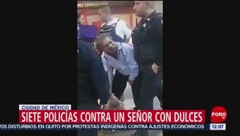 Policías del Metro CDMX intentan remitir a presunto vendedor de dulces