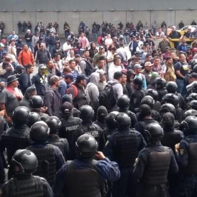 Se desata enfrentamiento entre policías federales y de CDMX, frente al AICM