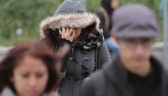 Foto: Una mujer se cubre el rostro por las bajas temperaturas en Tamaulipas. Cuartoscuro