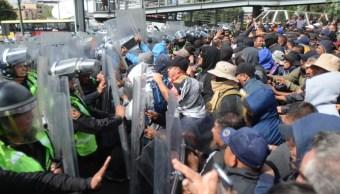 Protesta de policías durante llegada de Evo fue provocación, dice AMLO