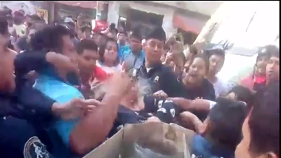 FOTO: Video: Golpean a mujeres acusadas de robar a niños, el 10 de diciembre de 2019