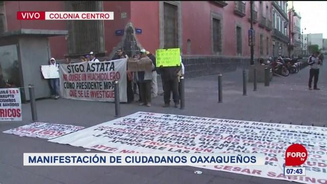 ciudadanos oaxaquenos se manifiestan en palacio nacional en cdmx