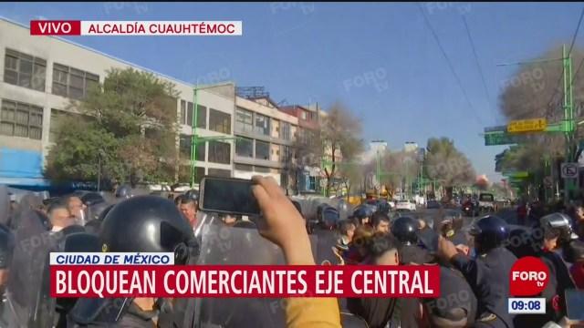 comerciantes bloquean eje central