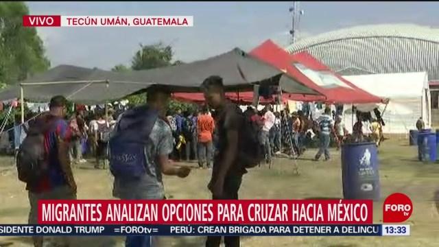 FOTO: migrantes analizan opciones para cruzar a mexico
