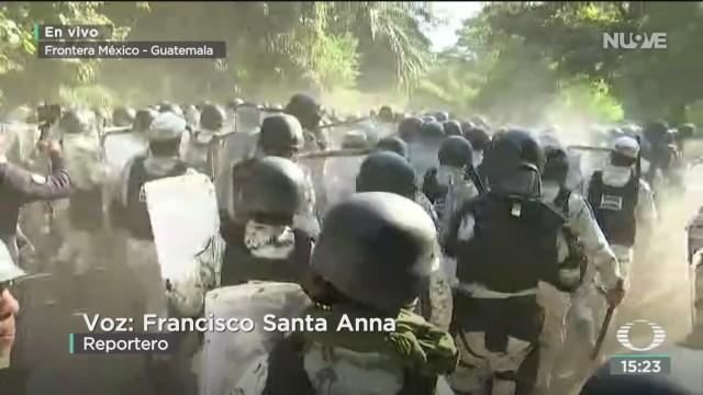 FOTO: nuevo altercado entre gn y migrantes en la frontera sur
