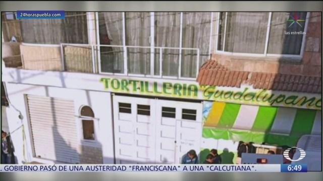 mujer asesinada en ataque contra tortilleria en puebla