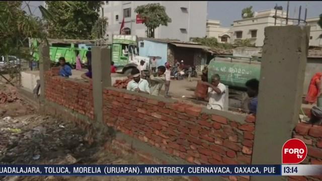 FOTO: protestan en india por muro construido para visita de trump