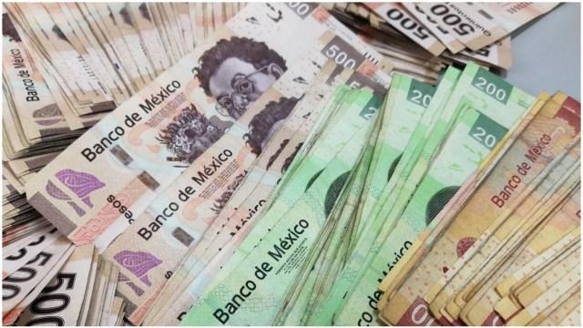 Foto: Peso mexicano cae tras proyecciones económicas y crisis laboral en EEUU por coronavirus, 1 de abril de 2020, (Getty, Archivo) )