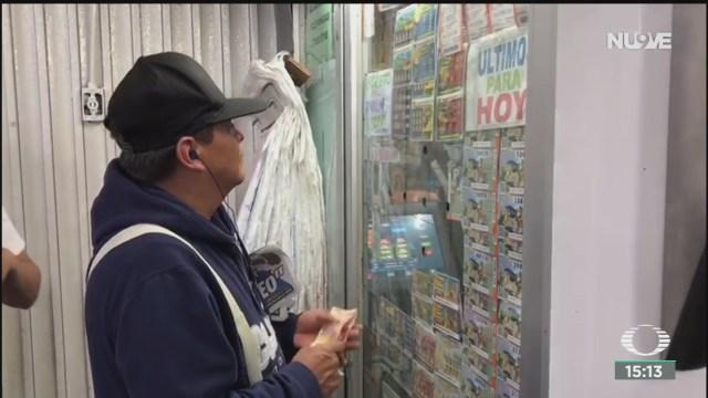 FOTO: salen a la venta boletos de loteria para avion presidencial