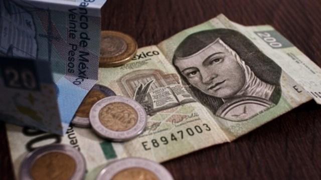 Foto: Monedas y billetes mexicanos. Getty Images