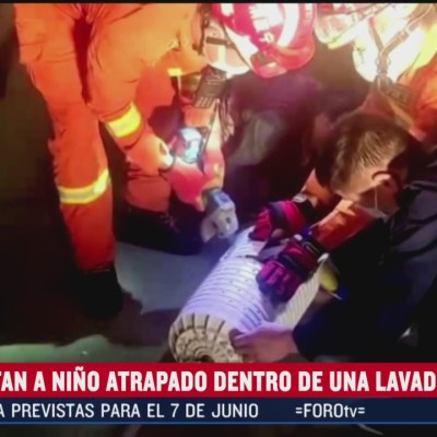Rescatan a niño atrapado en una lavadora