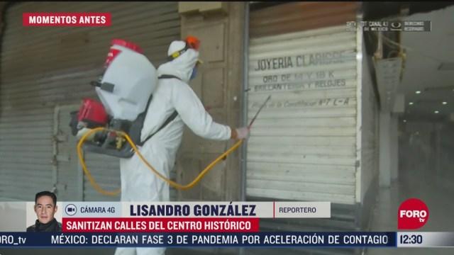 sanitizan calles del cetro historico en la cdmx