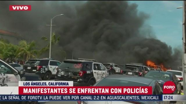 FOTO: 30 de mayo 2020, manifestantes se enfrentan con policias y queman automoviles en los angeles