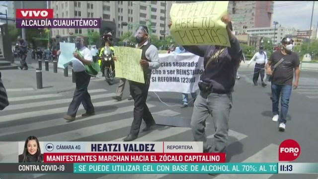Manifestantes marchan hacia el Zócalo de la CDMX