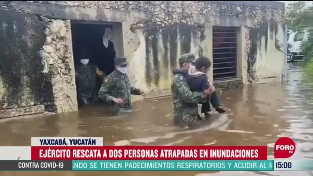 FOTO: militares rescata a personas atrapadas por inundaciones en yucatan