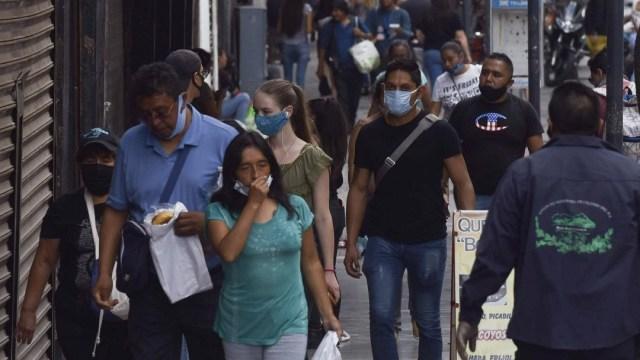 casos confirmados de coronavirus en mexico, personas con cubrebocas con soronavirus