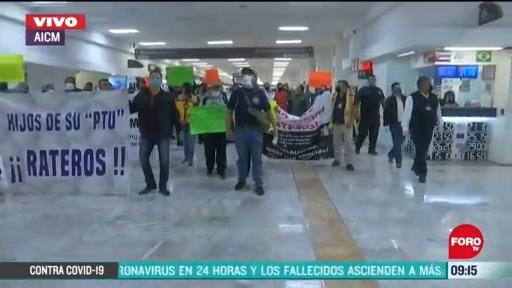 trabajadores del aeropuerto internacional de la cdmx se manifiestan en terminal