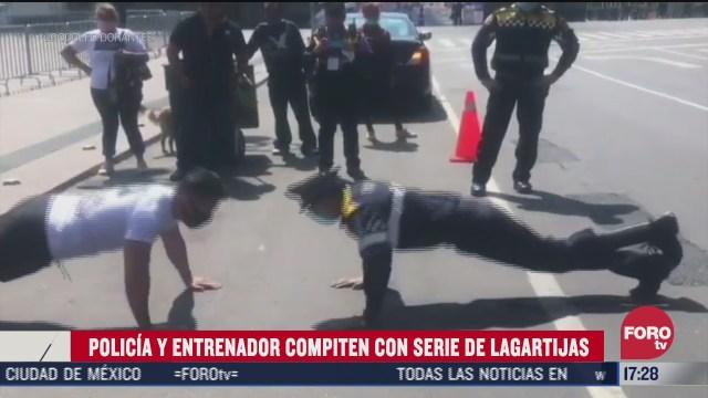 policia de cdmx y entrenador compiten en serie de lagartijas