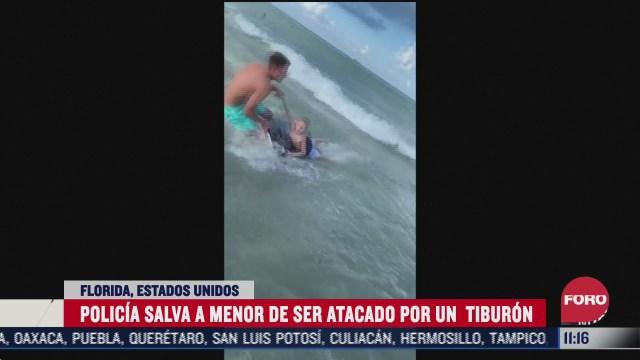 policia salva a menor de ser atacado por un tiburon
