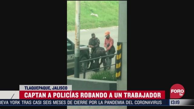 captan a policias de tlaquepaque robando a vendedor