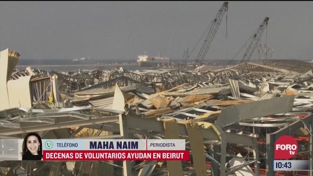 decenas de voluntarios ayudan en beirut libano