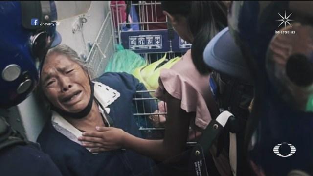 Policías de CDMX quitan mercancái de yerbas a anciana en Centro de CDMX