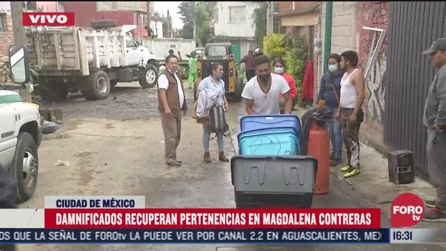 damnificados por lluvia en magdalena contreras realizan trabajos de limpieza