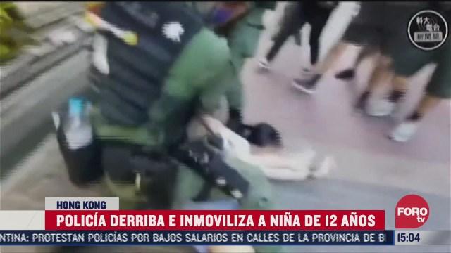 policia derriba a nina de 12 anos en protesta en hong kong