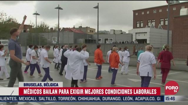 belgica decreta restricciones por covid 19 y medicos bailan