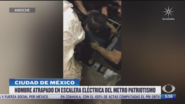 hombre queda atrapado en escaleras electricas del metro patriotismo