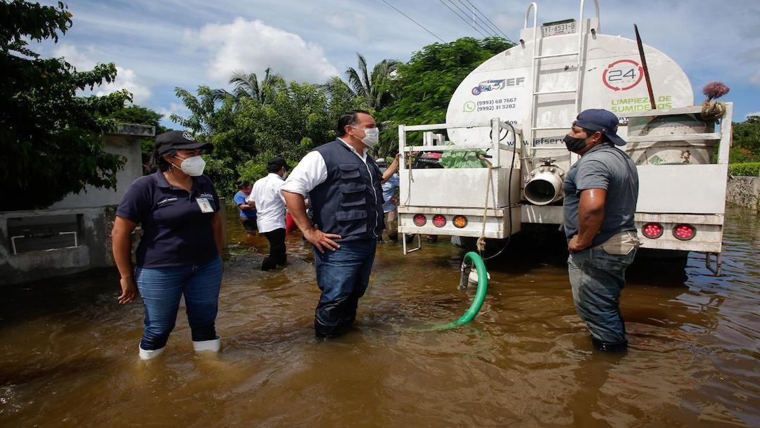 Persisten inundaciones en más de 10 colonias de Yucatán tras paso de ciclones
