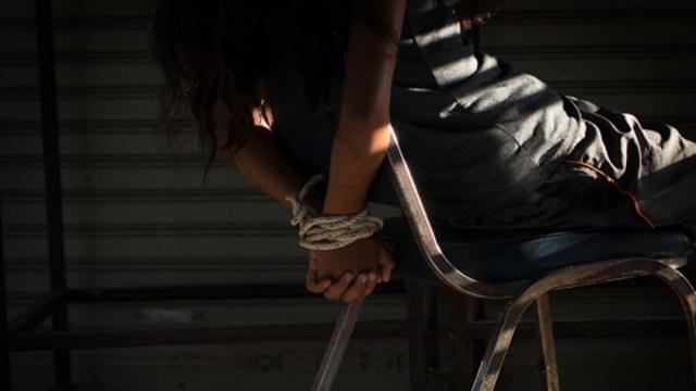 Imagen de una mujer privada de su libertad