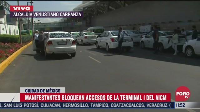 taxistas bloquean accesos al aicm