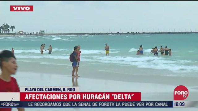 turistas regresan a playa del carmen tras paso de delta