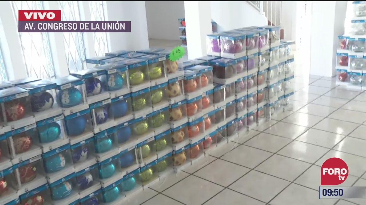artesanos de puebla venden esferas navidenas en la cdmx