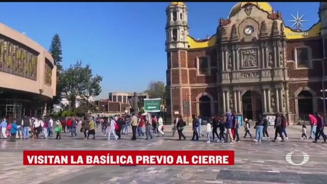 miles de personas acuden a la basilica de guadalupe previo al cierre