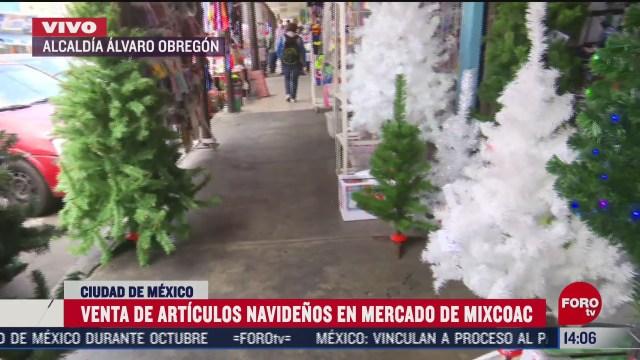 vendedores del mercado de mixcoac reportan bajas ventas de articulos navidenos por covid