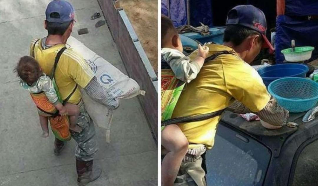 Albañil carga a su hijo en la espalda mientras trabaja