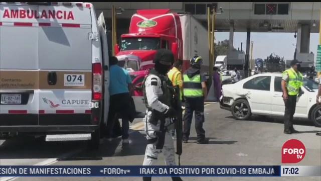 trailer se impacta con autos en caseta de puebla