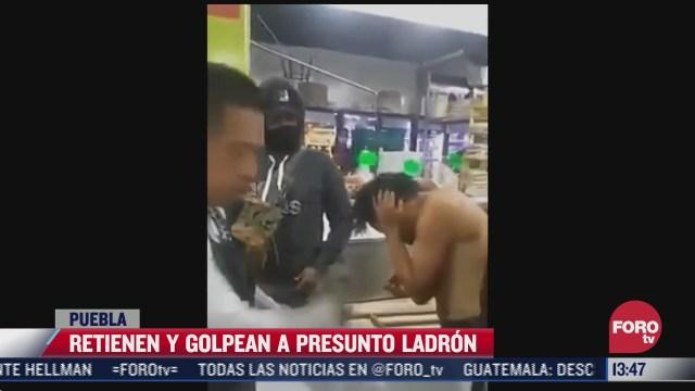 comerciantes golpean a presunto delincuente en la central de abasto de puebla