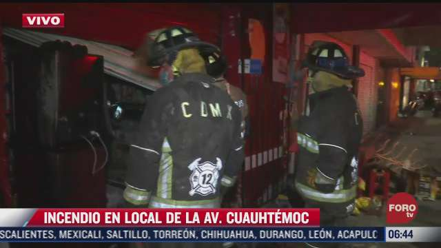 bomberos sofocan incendio en una tienda de abarrotes