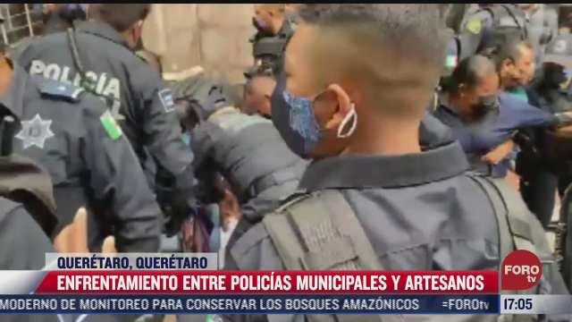 se registra enfrentamiento entre policias municipales y artesanos en queretaro