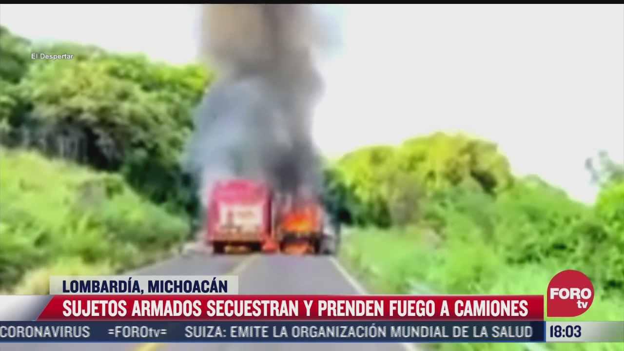 hombres armados secuestran y prenden fuego a camiones repartidores en michoacan