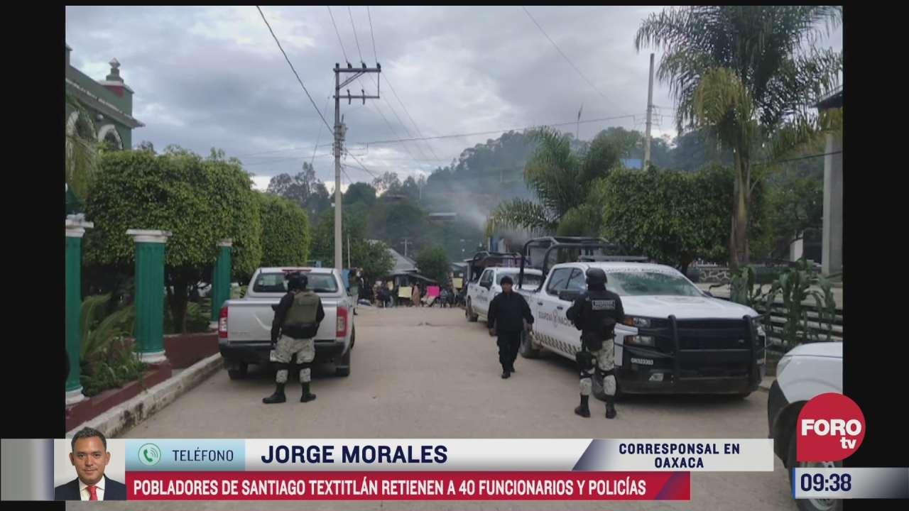 pobladores de santiago textitlan oaxaca mantienen retenidos a 40 funcionarios y policias