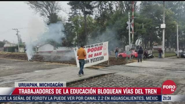 trabajadores de la educacion bloquean vias del tren en michoacan
