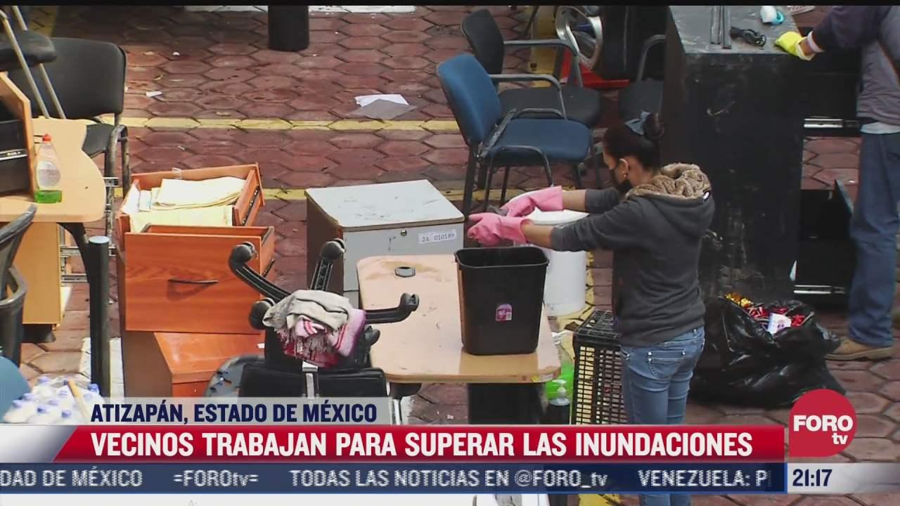 vecinos en atizapan continuan limpieza tras inundaciones