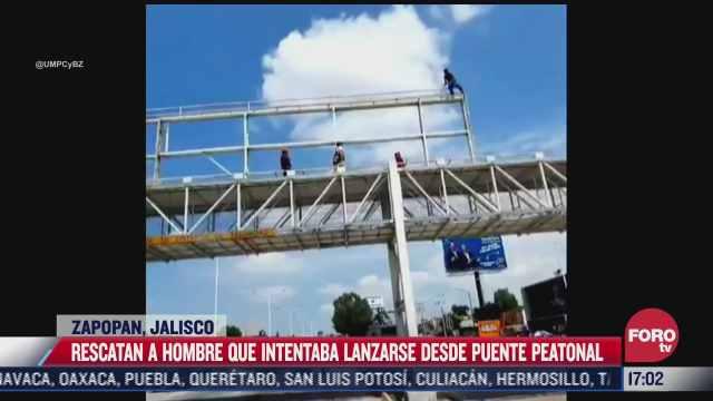 video rescatan a hombre que intentaba lanzarse de puente peatonal