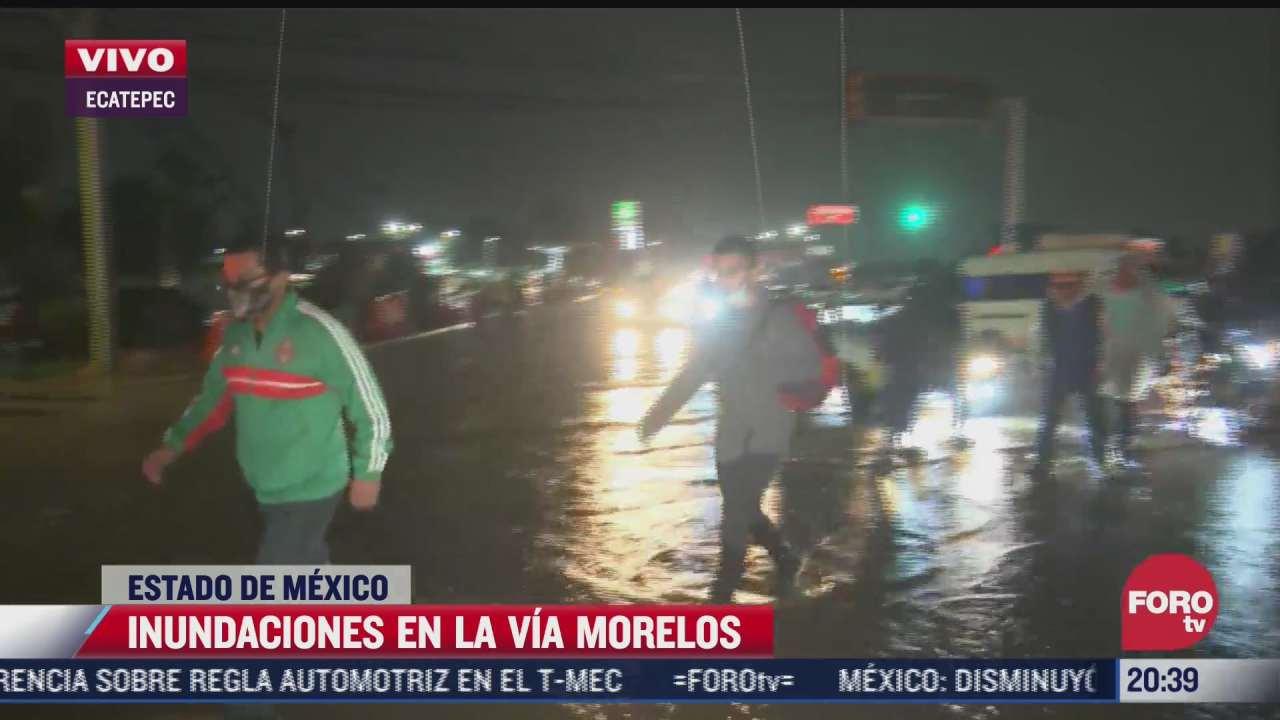 automoviles quedan varados por inundaciones en via morelos edomex