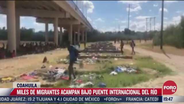miles de migrantes permanecen en bajo puente internacional del rio en coahuila